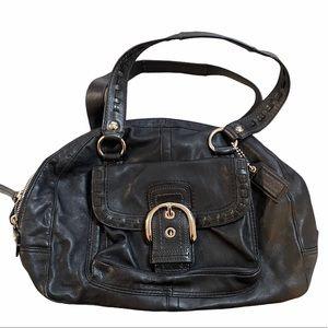 Coach leather purse. Buckle front flap.